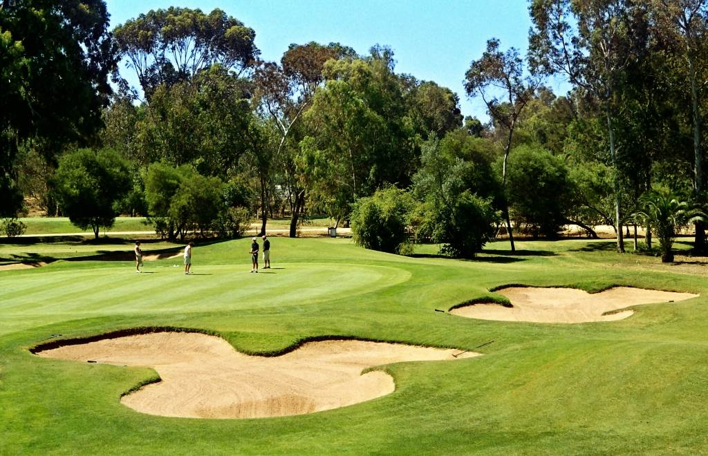Golfers on the Sir Henry Cotton Championship Course at Penina Hotel and Golf Resort